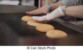 cuisiner chignon frais viande jeûne air cuisinier gants nourriture bun stock