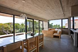 industrial house concrete house with industrial features on the beach by bak
