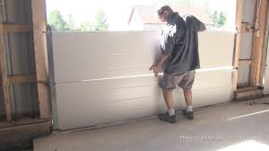 Garage Overhead Doors by How To Install A Garage Door Youtube