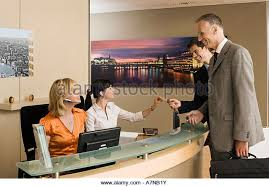 Two Person Reception Desk Two Women Behind Reception Desk Stock Photos U0026 Two Women Behind