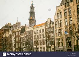 many different houses on canal in amsterdam stock photo royalty