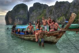 girls posing at maya bay on koh phi phi in thailand this is