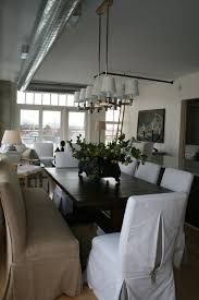 slipcovered parsons chairs loft dining room featuring our dublin dining table with slipcovered