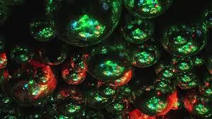 mirror balls reflect rays of colored lights colorful reflective