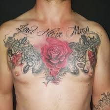 and guns tattoos on chest