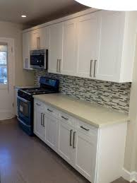 maple cabinets with white countertops white shaker maple cabinets with quartz countertop and linear