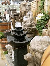 19 best garden decor containers pots statues water features and