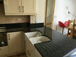 granite countertop mocha shaker cabinets slimline dishwasher