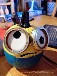decorating and painting minion pumpkins for halloween