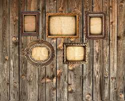 set of empty picture frames on wooden wall stock photo colourbox