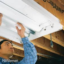 how to change a fluorescent light fixture how to replace a fluorescent light bulb family handyman