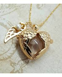 gold wing necklace images Here 39 s a great price on angel wings locket with fillable glass orb