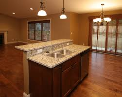 two level kitchen island designs this two level island design hides sink from sight integrating a