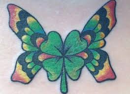 4 leaf clovers with flowers four leaf clover tattoo ideas