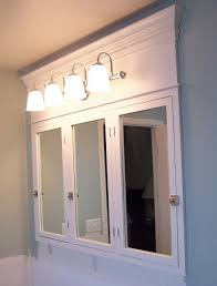 tri fold mirror bathroom cabinet diy medicine cabinet we can still keep the tri fold functionality