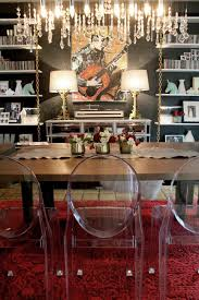this eclectic dining room features white bookshelves with chains