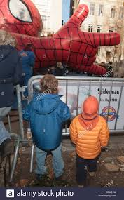 spiderman thanksgiving two young boys watching the inflation of the spiderman balloon the