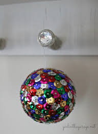 diy sequin tack ornaments in the garage