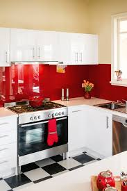 Hafele Kitchen Designs A Retro Kitchen With Bright Red Splashback Completehome