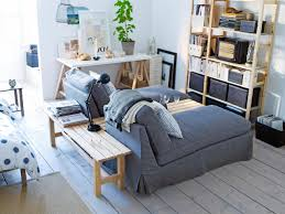 furniture grey couch with wood bench and wooden flooring plus