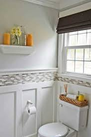 bathroom with wainscoting beadboard bathroom sink and toilet