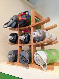 looking for a tidy way to stash your camelbak bottles use a wine