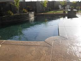 fantastic modern stamped concrete pool deck decoration ideas with