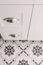 white gray and black mosaic cement tile floor transitional