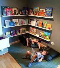 gutter bookshelves for playroom with behr hazelnut cream walls