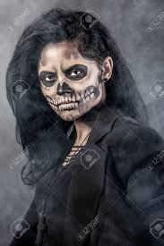 woman mask halloween young woman in day of the dead mask skull face art halloween