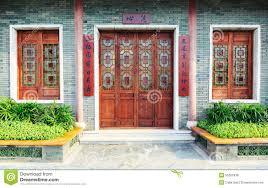 House Front Door Wooden Front Door Wood Window Of Chinese Classic House Stock Photo