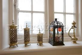 la012 27 assorted lanterns on windowsill of new malde narratives