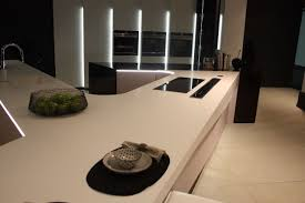 black solid surface countertop white under mount sink and faucet