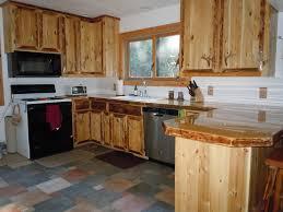 Shaped Kitchen Island Made Of Cedar Tree Designs Pinterest | rustic custom cedar wood kitchen cabinets wood kitchen cabinets