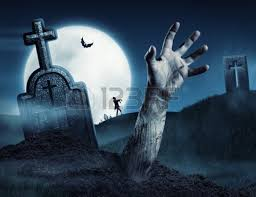 zombie hand coming out of his grave full moon halloween fall