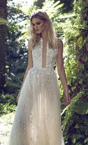 beautiful floaty embellished lace wedding dress with beaded and