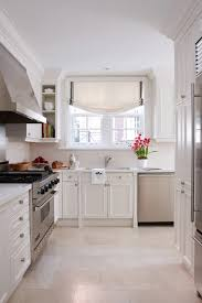 white kitchen cabinets tile floor staggered kitchen tile floor traditional kitchen