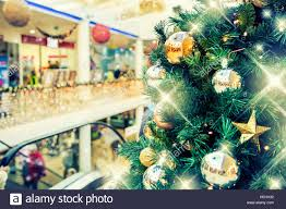 christmas tree with gold decoration in shopping mall christmas