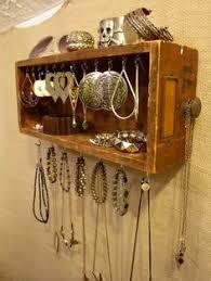 diy jewelery holder a cork board covered in a burlap sack
