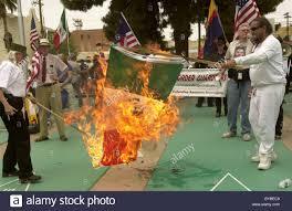 Flag Burning Protest Demonstrators Burn The Flag Of Mexico In April 2006 In Tucson