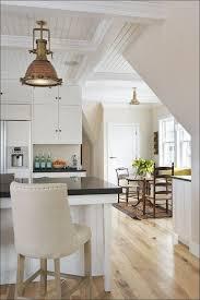 Coastal Kitchens - kitchen coastal round dining table dining room tables coastal