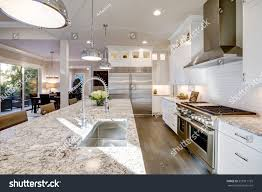 kitchen designs with granite countertops white kitchen design features large bar stock photo 555911155