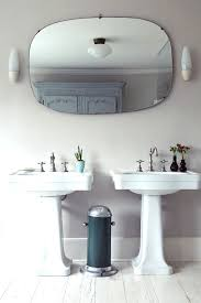 fabulous wall sconces and black mat for small vintage bathroom