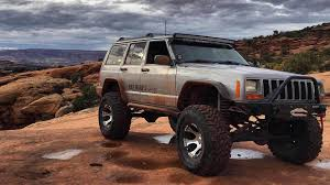 jeep driving away watch this jeep cherokee climb up a nearly vertical rock face easy
