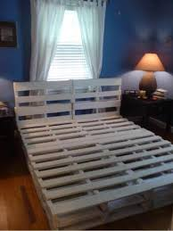 using wood pallets make a bed frame just sand the pallets to