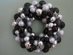 raiders ornament wreath wrapped in black by grandmaswreaths