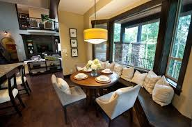 modern dining room with hardwood floors by shannon ponciano