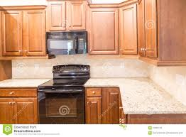 Kitchen Granite by New Kitchen With Granite Countertops And Black Appliances Stock