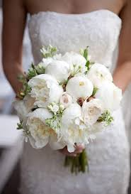 white bouquet an all white bouquet with lush peonies and garden roses brides