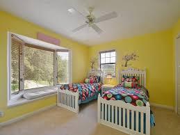 traditional kids bedroom with bay window mural zillow digs traditional kids bedroom with ceiling fan bay window window seat mural carpet